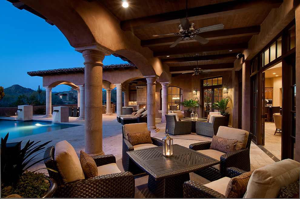 Craftmade Patio Mediterranean with Arches Beams Ceiling Fan Outdoor Seating Pool Posts Travertine Wicker Wood Ceiling