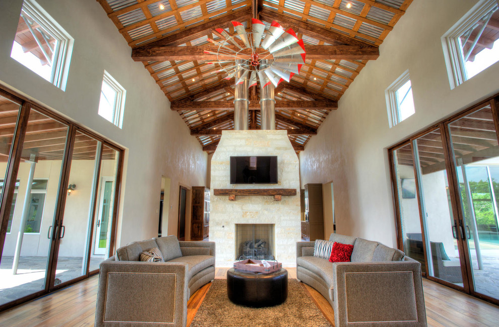 Craftmade Ceiling Fans Living Room Farmhouse with Area Rug Curved Sofas Dark Stained Wood Gray Walls Metal Roof Open
