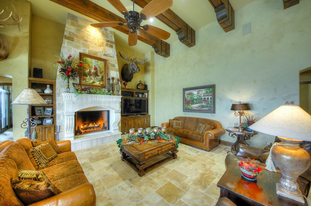 Craftmade Fans Living Room Mediterranean with Beamed Ceiling Boerne Burdick Christofilis Burdick Custom Homes Burdick Homes Custom Home