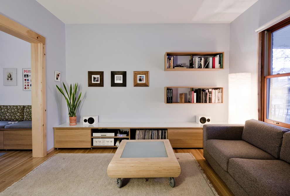 Crosley Record Players Living Room Modern with Area Rug Banquette Seating Brown Sofa Coffee Table on Casters Floating Bookshelves