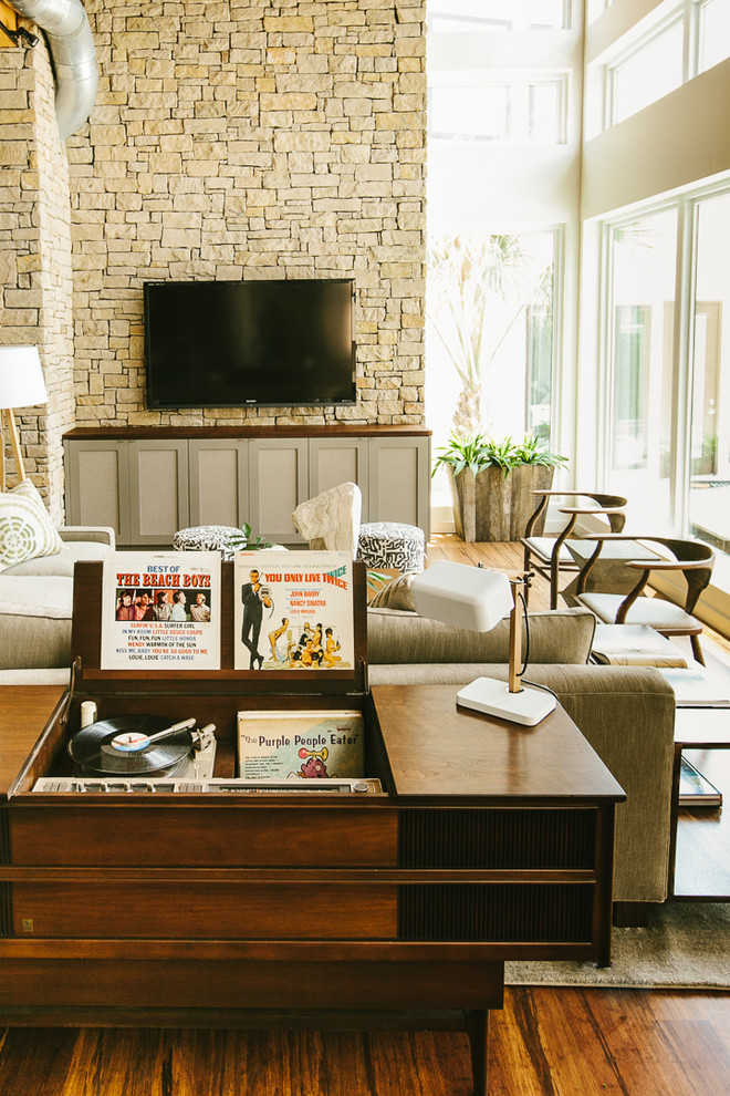 crosley turntable Living Room Midcentury with beige sectional beige sofa gray media console music player natural lighting oversized