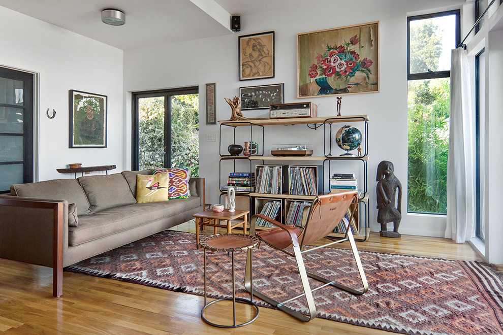 Crosley Turntable Living Room Scandinavian with Americana Art Bookshelves Clean Eclectic Leather Chair Minimal Modern Side Table Sofa