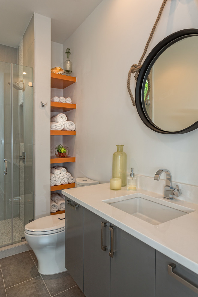 cubby shelves Bathroom Contemporary with glass shower door guest bathroom open shelving orange shelving round mirror