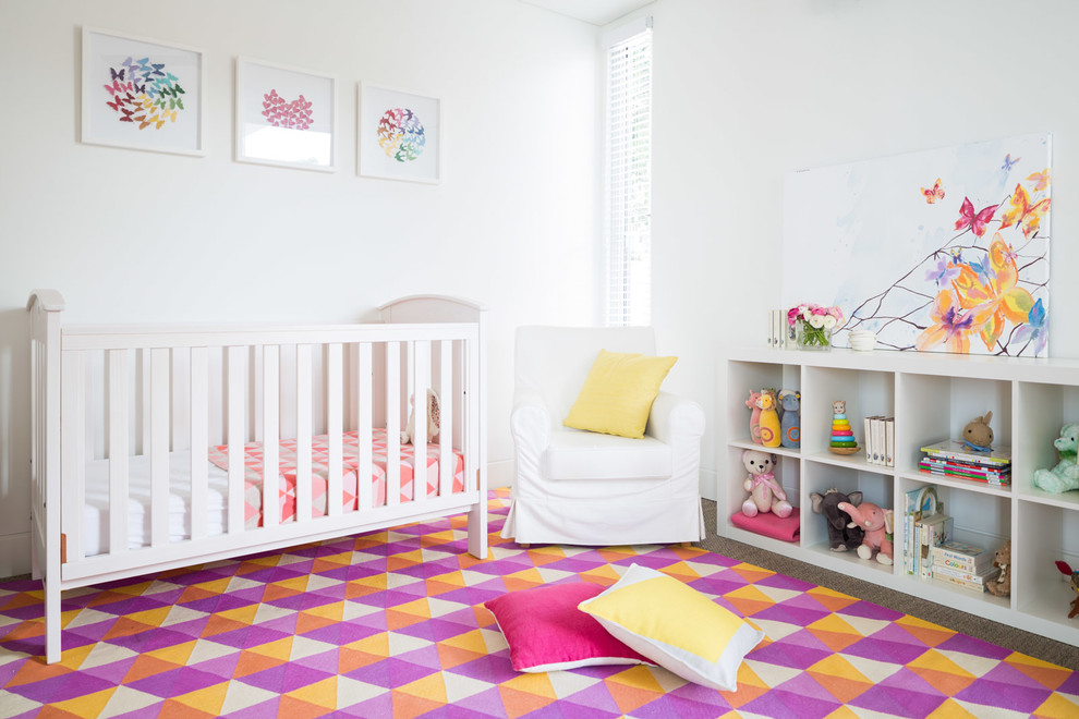 Cube Shelf Nursery Contemporary with Butterfly Theme Colourful Framed Artwork Purple Orange Geometric Area Rug Toys White