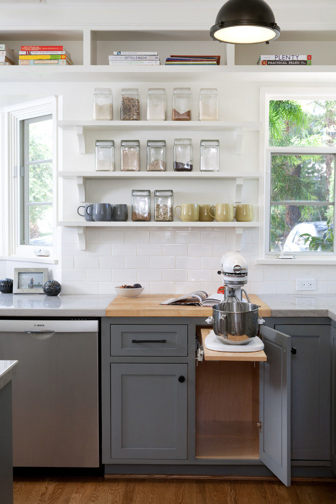 cuisinart stand mixer Kitchen Transitional with butcher block cookbook storage glass storage containers open shelves pullout counter white