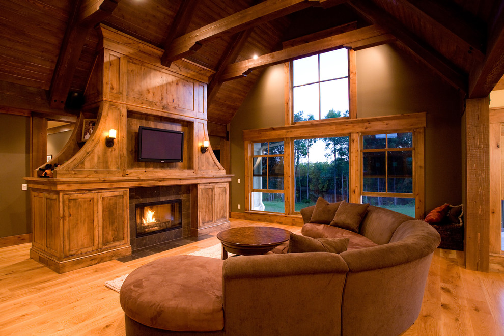Curved Couch Family Room Farmhouse with Barn Beams Fireplace High Ceiling Patio Door Round Sofa Tv Above Fireplace