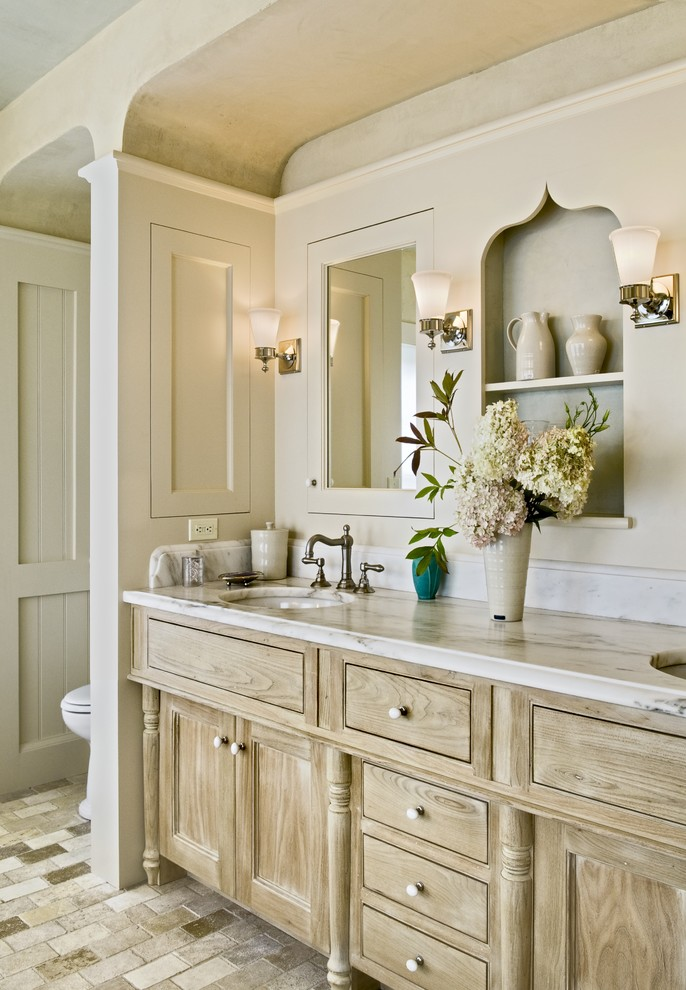 Danby Silhouette Bathroom Traditional with Built Ins Distressed Finish Cabinets Double Sinks Double Vanity Limestone Floors Marble Countertops