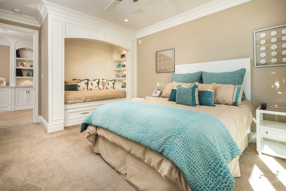 Daybed Frame Bedroom Beach with Bed Alcove Beige Carpet Blue Bedding Built in Bookshelves Calm Ceiling Fan