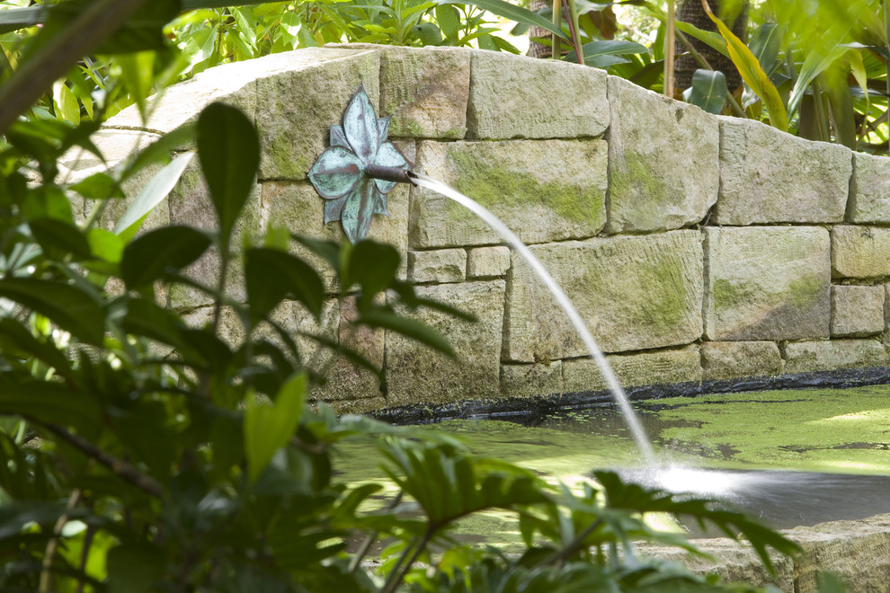 Designers Fountain Landscape Modern with Fountain Lush Overgrown Pond Stone Wall Water Feature