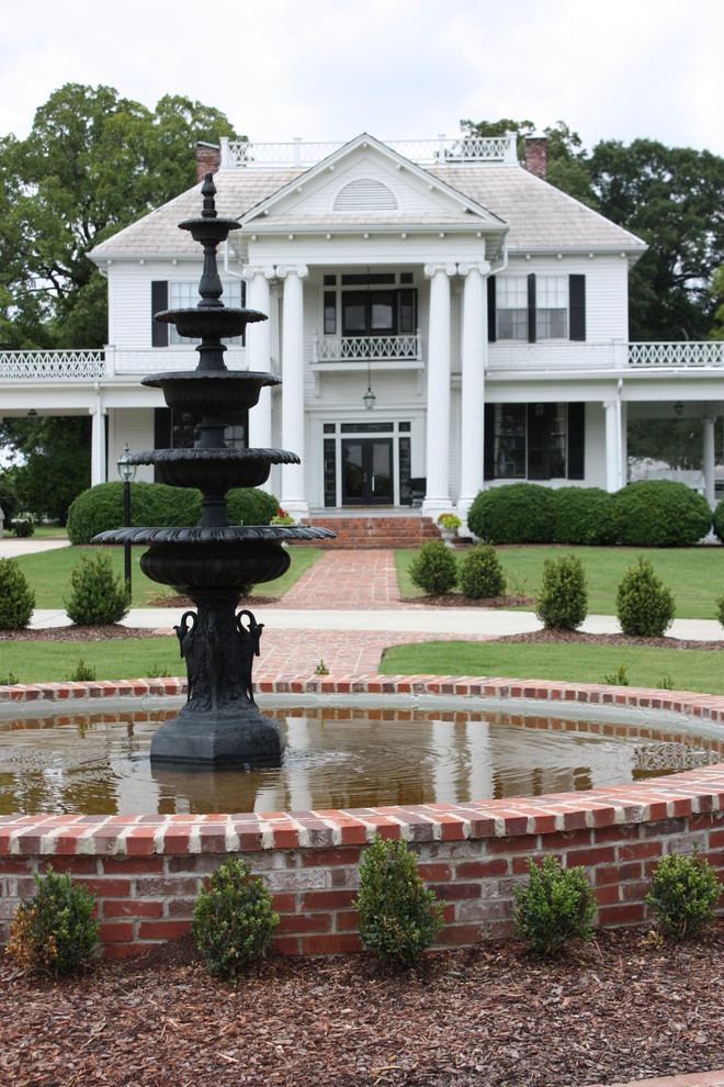 Designers Fountain Landscape Traditional with Balcony Black Front Door Black Window Shutters Brick Fountain Brick Pathway Brick