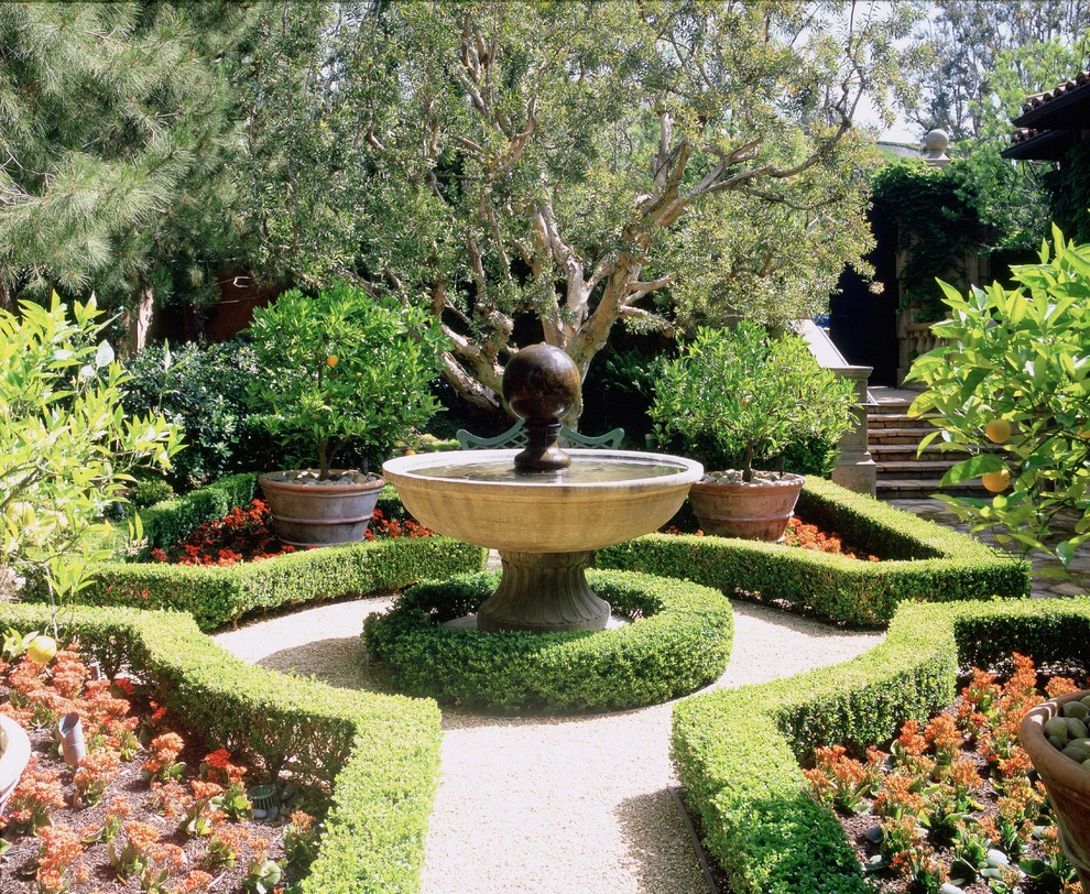 designers fountain Landscape Traditional with fountain gravel gravel path hedge parterre steps terra-cotta water feature