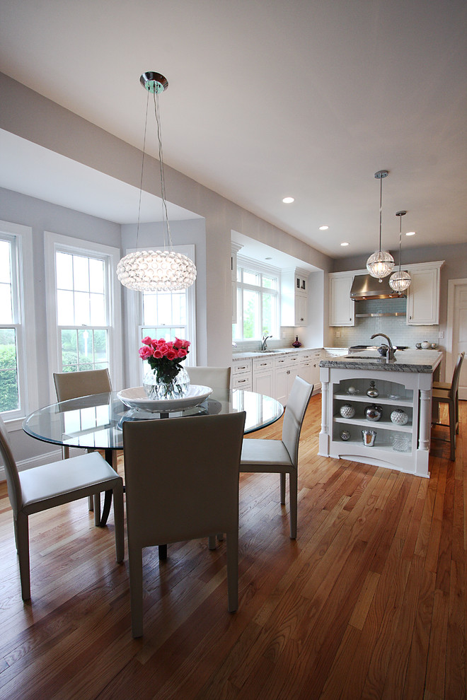dinette tables Kitchen Traditional with breakfast bar centerpiece contemporary chandelier eat in kitchen floral arrangement glass dining