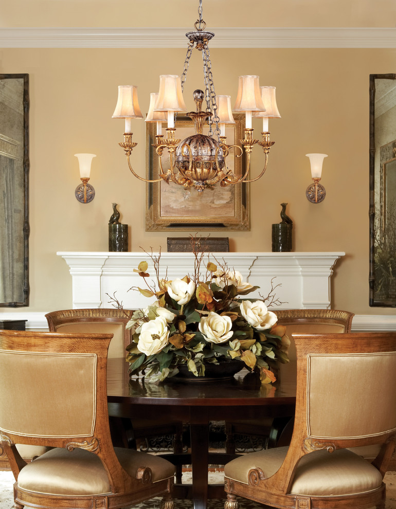 dining room table centerpieces Dining Room Traditional with beige champagne chandelier flower arrangement mantle pedestal table round table sconces tan