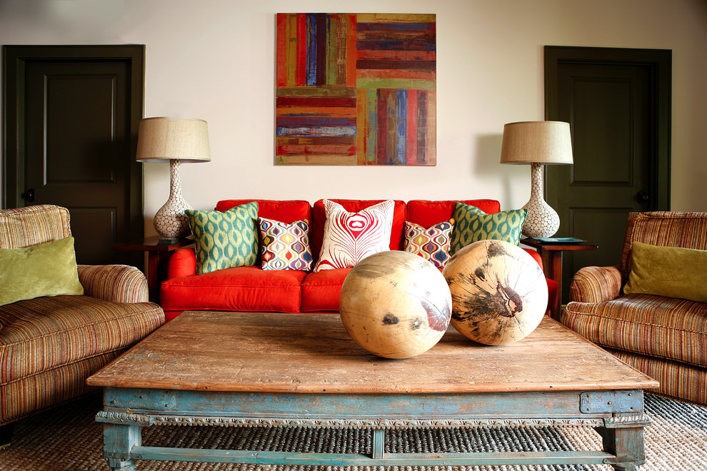 Distressed Coffee Table Living Room Transitional with Artwork Collected Colorful Pillows Distressed Red Couch Rustic Striped Armchairs Wall Art