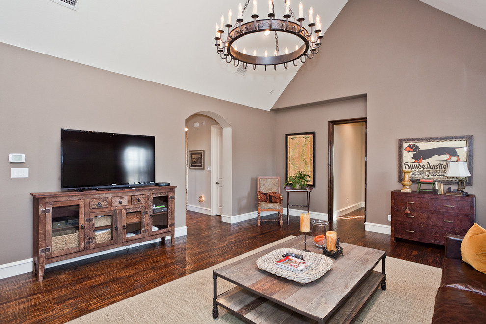 Distressed Tv Stand Family Room Traditional with Arched Doorway Artwork Brown Sofa Cathedral Ceiling Chandelier Coffee Table Basket Entertainment