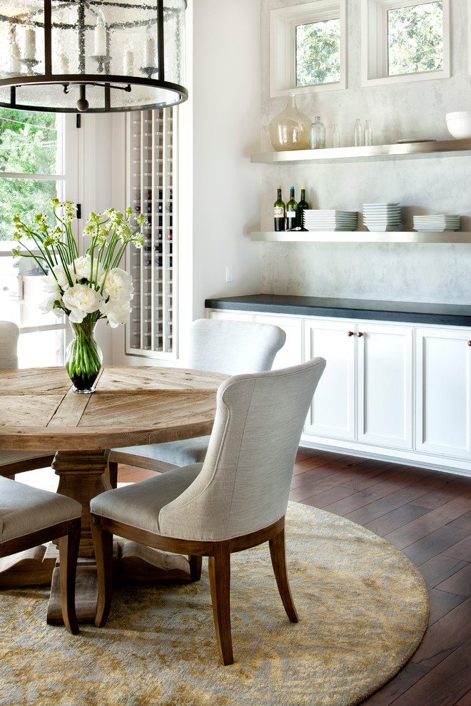 Distressed Wood Dining Table Dining Room Traditional with Black Countertop Built in Wine Rack Built in Wine Storage Circular Rug Dark Wood