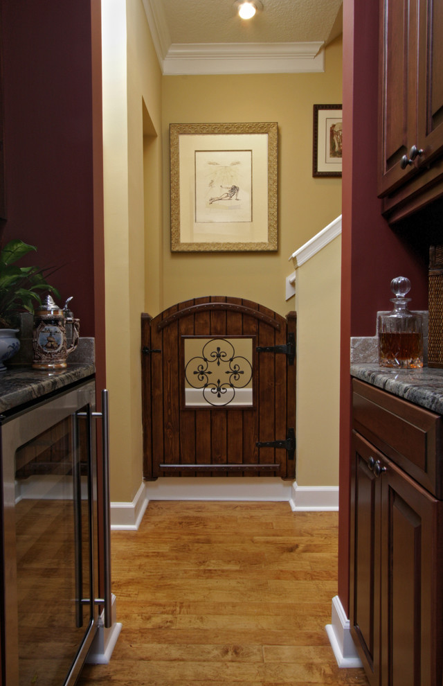 dog gates for stairs Kitchen Mediterranean with baby gate butlers pantry iron scrolls olde world wine refrigerator wood floor