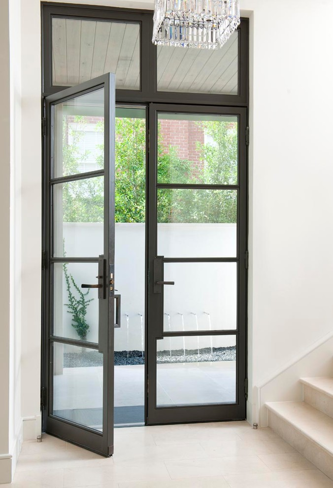Door Stopper Entry Contemporary with Crystal Light Entry Fountain Glass Doors Hallway Overhang Patio Pebbles Staircase Tile