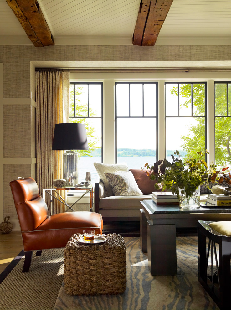 Door Stopper Living Room Beach with Area Rug Beige Curtains Black Lampshade Exposed Wood Beams Layered Rugs Medium