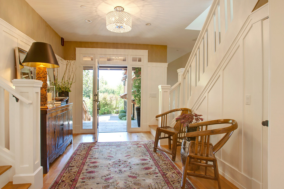 Doorbell Chimes Entry Transitional with Ceiling Lighting Crystal Drum Shade Rug Sideboard Stairs Transom Window Wainscoting White