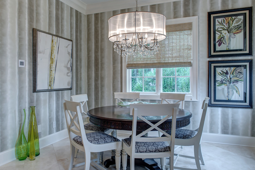 Drum Chandelier Dining Room Transitional with Artwork Baseboard Blue Seat Cushions Chandelier Crown Molding Green Glass Vases Round