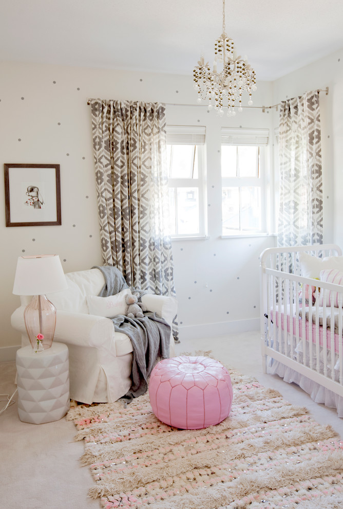 Dutailier Glider Nursery Eclectic with Pink Accents Pink Pouf Small Chandelier Wallpaper White Crib White Glider