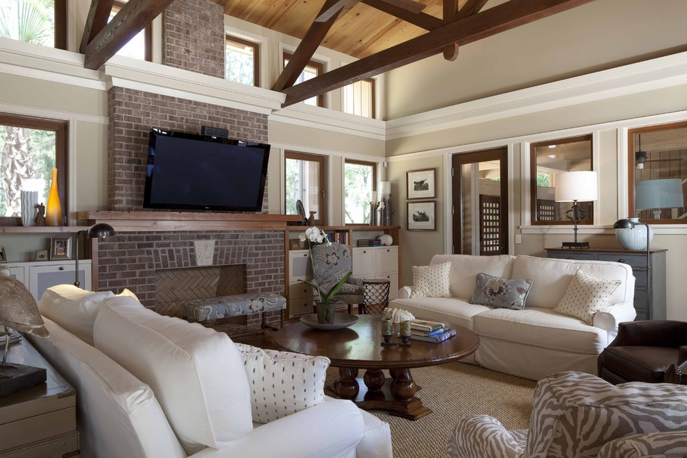 Eddie Bauer Furniture Living Room Contemporary with Beams Brick Fireplace Cathedral Ceiling Round Coffee Table Slipcover White Sofa Zebra