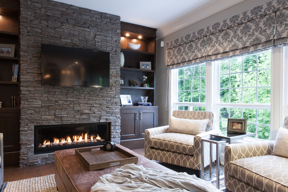 Electric Wall Mount Fireplace Family Room Traditional with Brown Ottoman Built in Bookcase Built in Cabinets Built in Shelves Dark Wood Cabinets Gray