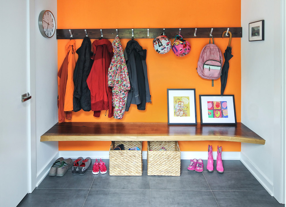 Entry Way Bench Entry Contemporary with Bright Orange Wall Gray Floor Tile Hanging Hooks Live Edge Orange Accent