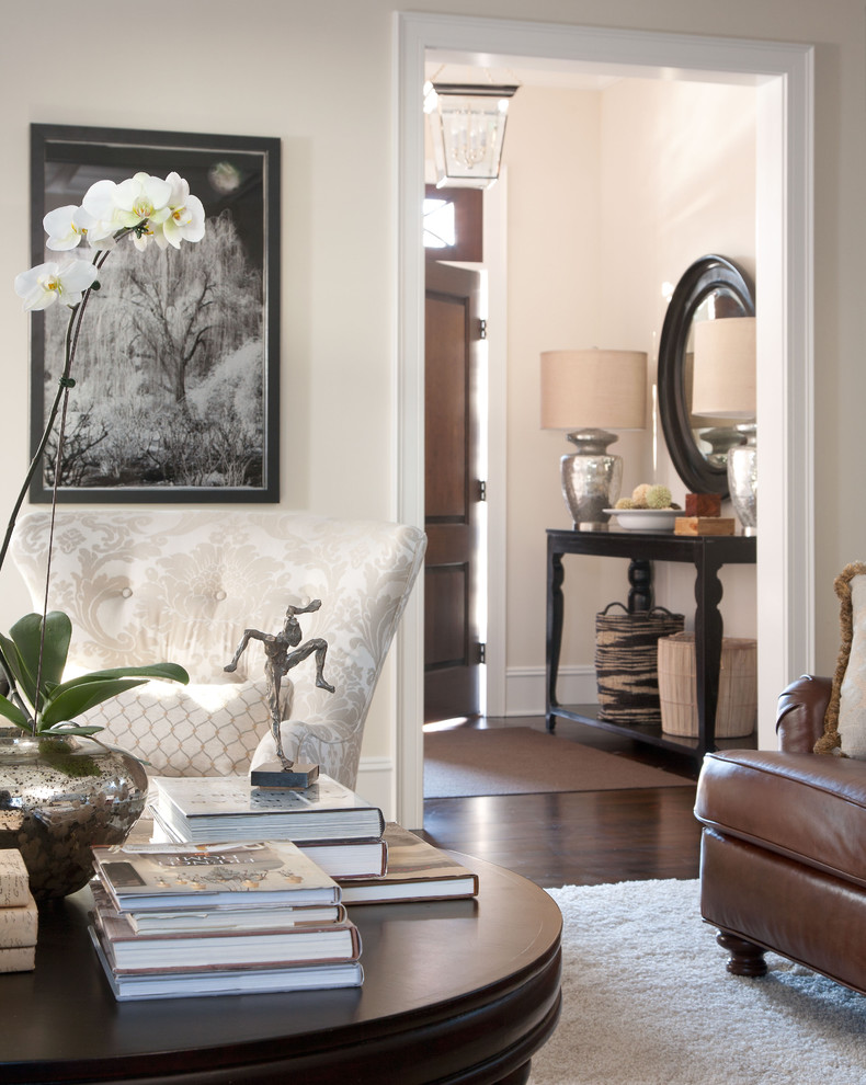 Entryway Mirror Living Room Traditional with Area Rug Artwork Baskets Beige Patterned Armchair Beige Wall Coffee Table Books