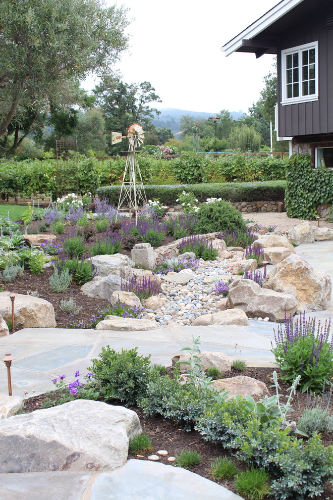 eva dry dehumidifier Landscape Mediterranean with bluestone board and batten boulders dry creek garden lighting garden path grape