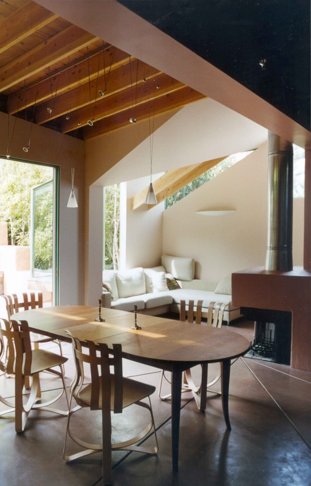 Extendable Dining Table Dining Room Contemporary with Beams Concrete Floor Fireplace Garden Gehry Gehry Hat Trick Chair Glass Pendant
