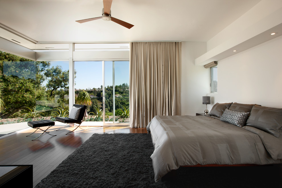 Feather Bed Topper Bedroom Modern with Ceiling Fan Clerestory Windows Contemporary Corner Window Curtains Glass Walls Gray Bedspread