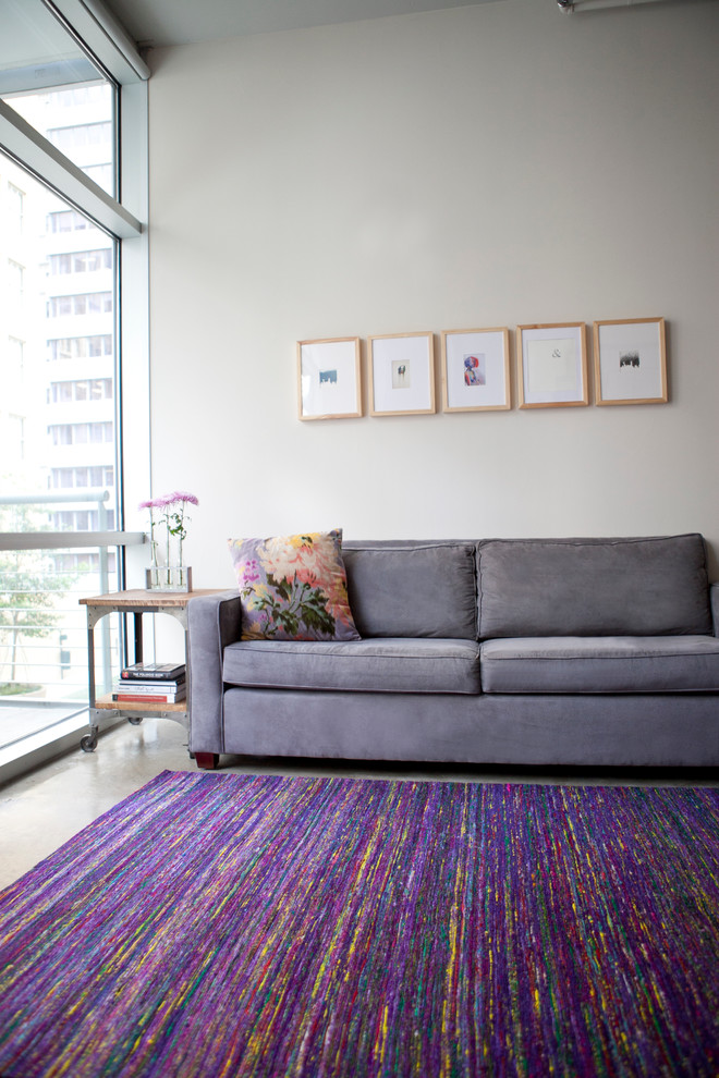 feizy rugs Family Room Contemporary with artwork city colorful floor-to-ceiling windows floral pillow industrial cart lavender sofa metal