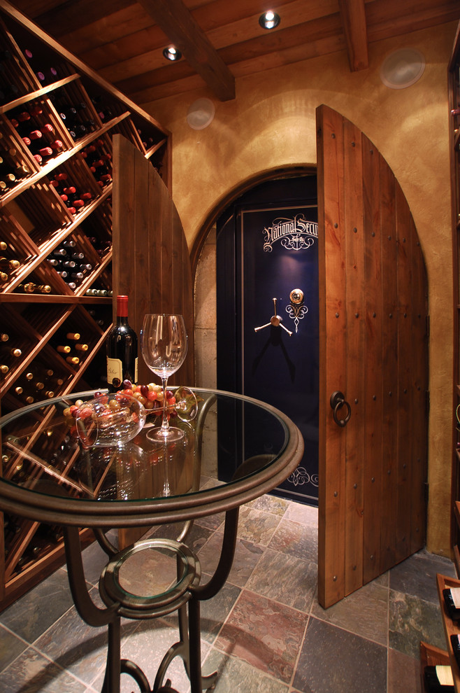Fireproof Safe Wine Cellar Traditional with Arched Doors Arched Doorways Beige Textured Wall Exposed Wood Beams Glass Bistro