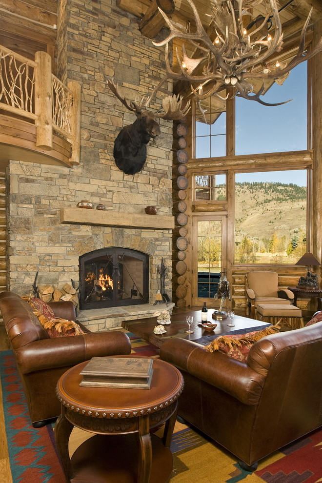 Fireside Lodge Furniture Living Room Rustic with Fireplace Jackson Hole Leather Arm Chair Logs Moose Mountain Nail Head Detail