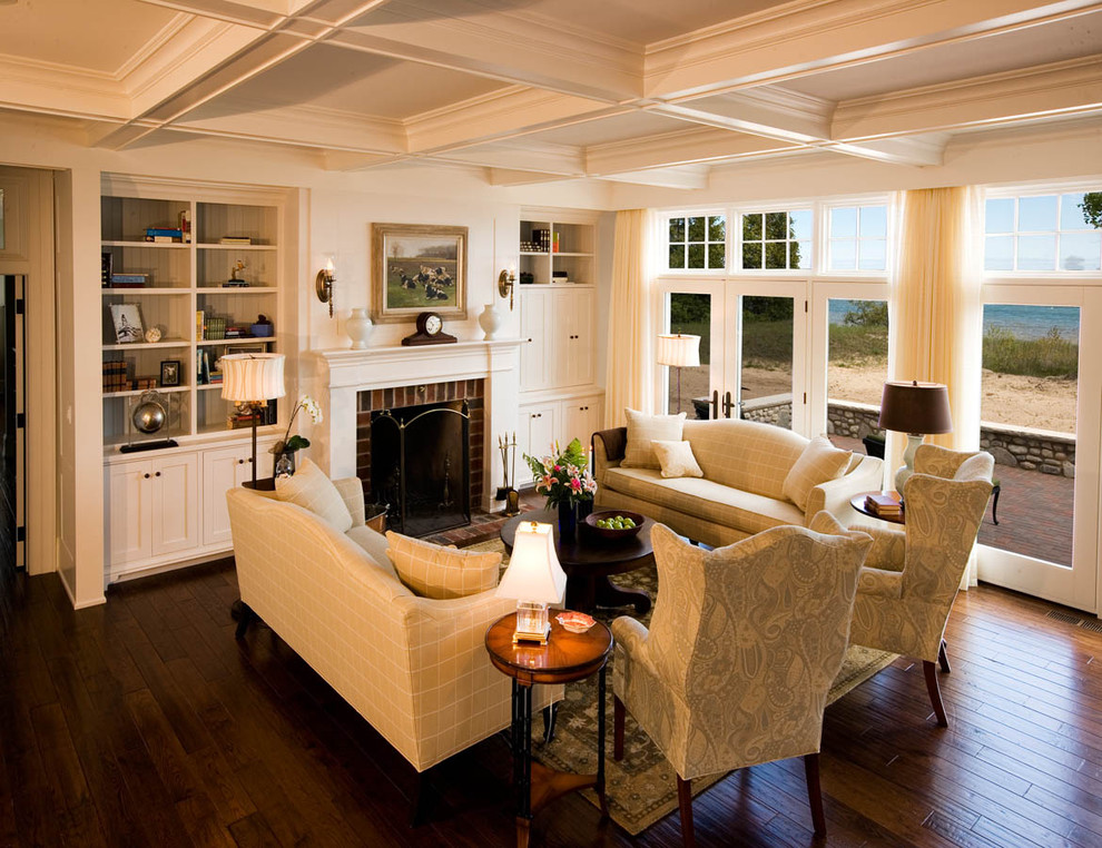 Fireside Lodge Furniture Living Room Traditional with Bookshelves Brick Fireplace Surround Built in Shelves Built in Storage Coffered Ceiling Dark Floor