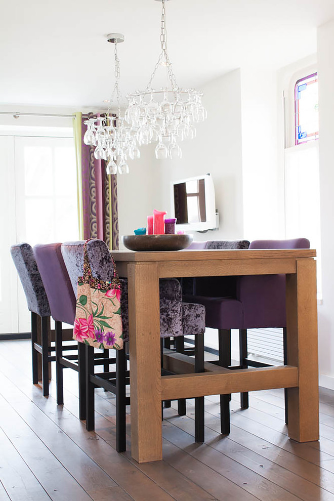 Flameless Taper Candles Dining Room Contemporary with Bright Colors Crushed Velvet Chairs Dark Wood Floor Feminine Color Scheme High