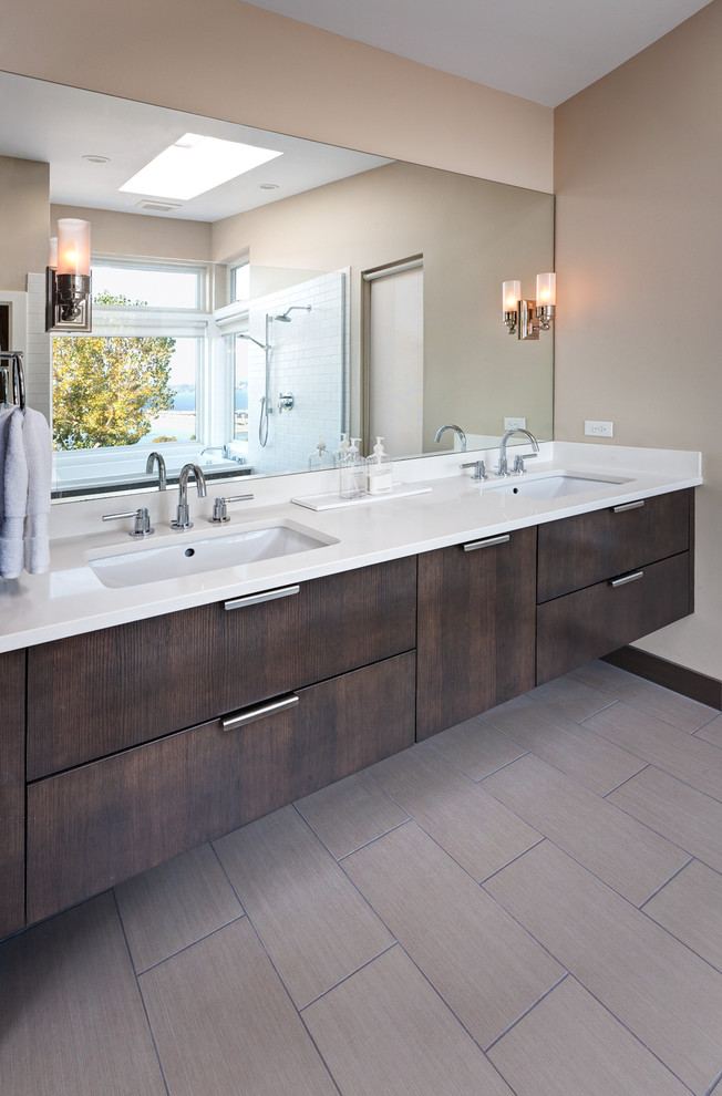 floating vanity Bathroom Transitional with brown baseboard chrome hardware double sinks floating vanity khaki wall mirror neutral