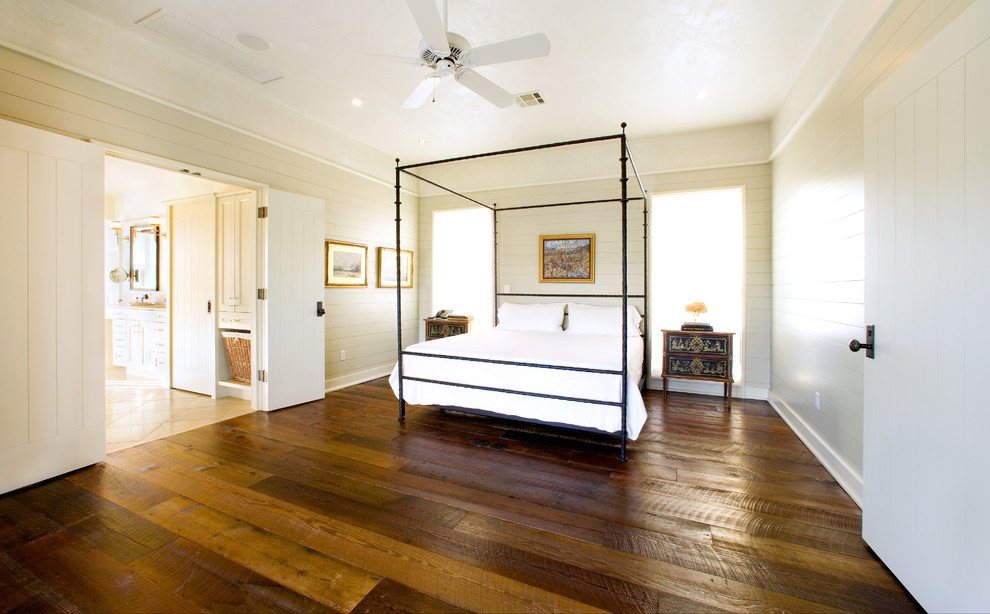 Floating Vinyl Plank Flooring Bedroom Rustic with Baseboards Bedside Table Canopy Bed Carriage Doors Ceiling Fan Crown Molding Dark