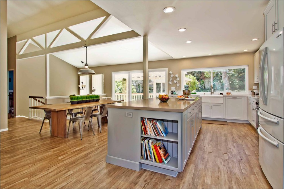 Floating Vinyl Plank Flooring Kitchen Contemporary with Farmhouse Sink Industrial Light Kitchen Island Pendant Light Vaulted Ceiling Wood Beams