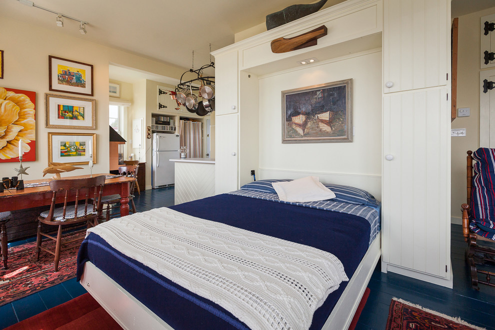 Folding Bed Frame Bedroom Beach with Blue Bedding Blue Floor Cream Walls Fold Out Bed Fold Up Bed Multi Purpose Space