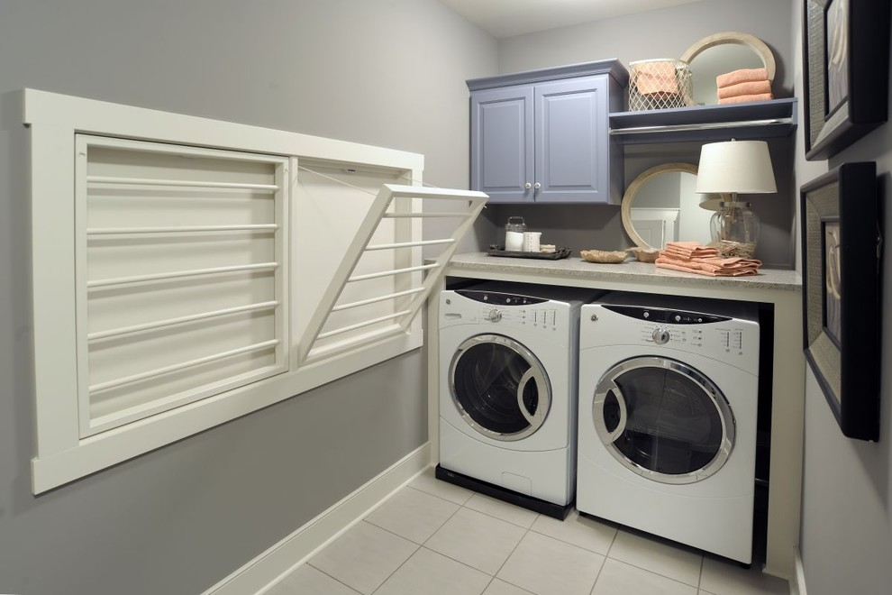 Folding Luggage Rack Laundry Room Traditional with Baseboards Drying Rack Front Loading Washer and Dryer Gray Walls Laundry Room White