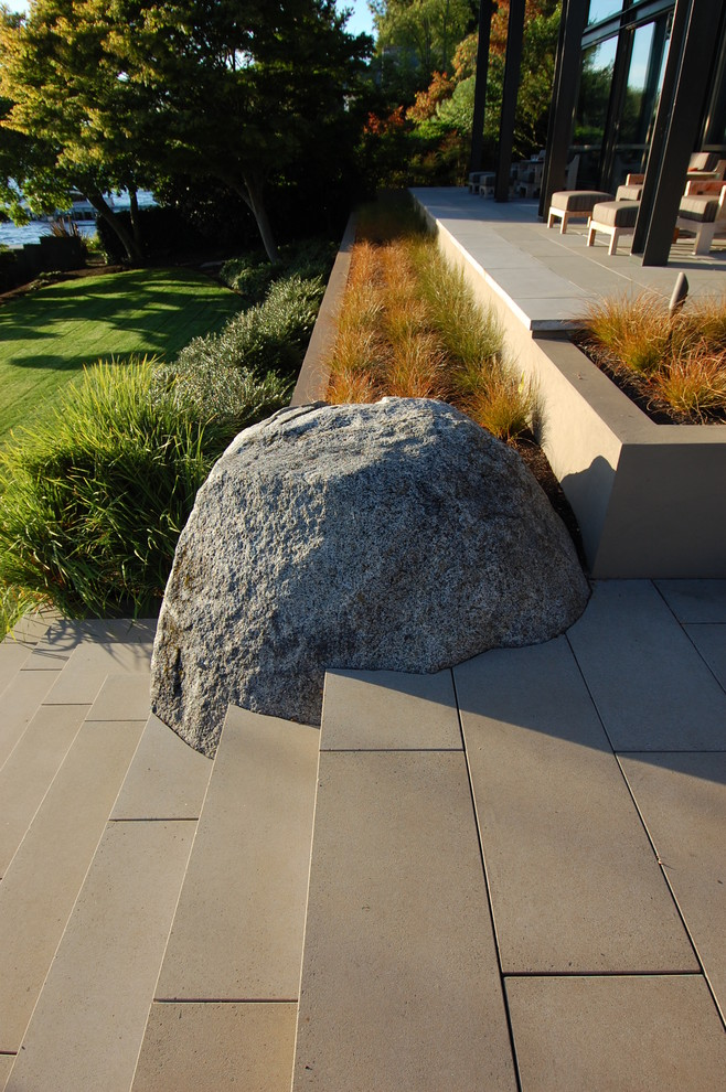 Fondue Sets Patio Modern with Boulder Boulders Chaise Lounge Concrete Paver Deck Grass Grasses Lawn Mass Plantings