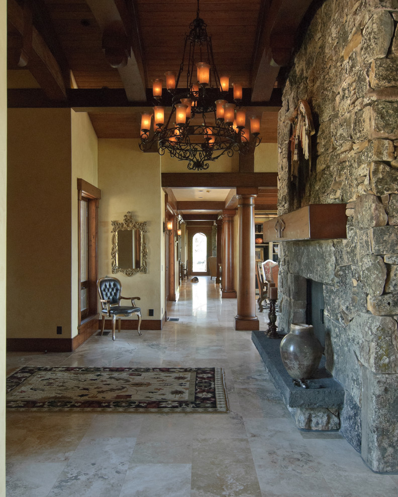 Foyer Chandelier Entry Mediterranean with Area Rug Ceiling Lighting Chandelier Exposed Beams Fireplace Hearth Fireplace Mantel Foyer