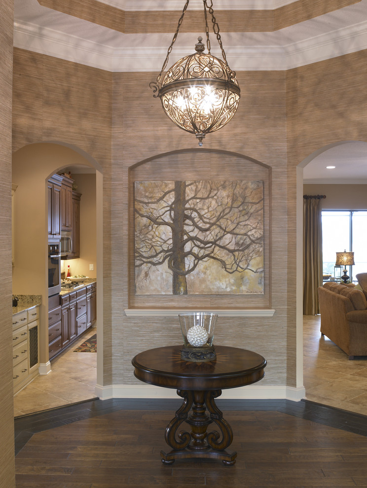 Foyer Chandelier Entry Traditional with Alcove Arched Doorways Artwork Crown Molding Dark Stained Woos High Ceiling Kitchen