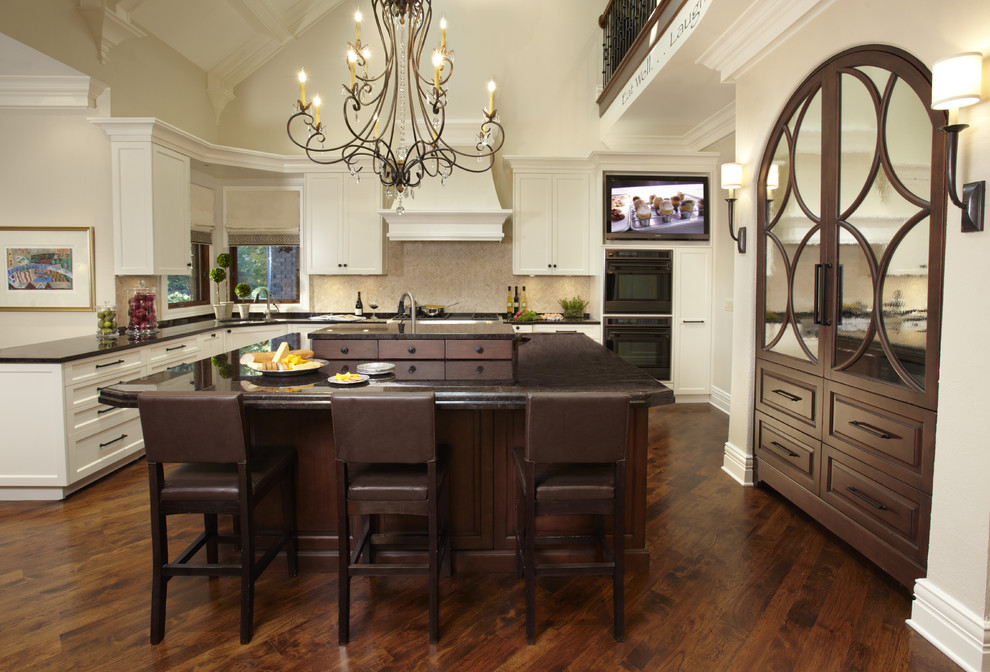 Framburg Lighting Kitchen Traditional with Barstools Chandelier Dark Countertop Dark Wood Floor Dark Wood Island Integrated Range