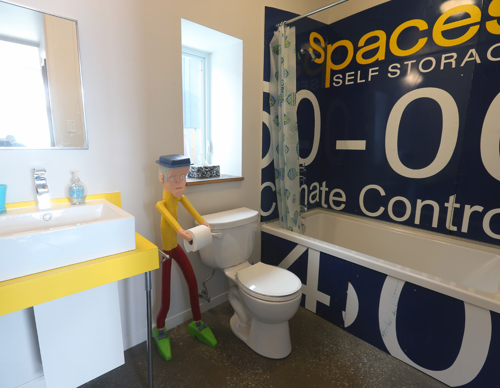 Free Standing Toilet Paper Holder Bathroom Eclectic with Bathtub Comical Concrete Floor Playful Salvaged Sign Shower Curtain Shower Over Bathtub