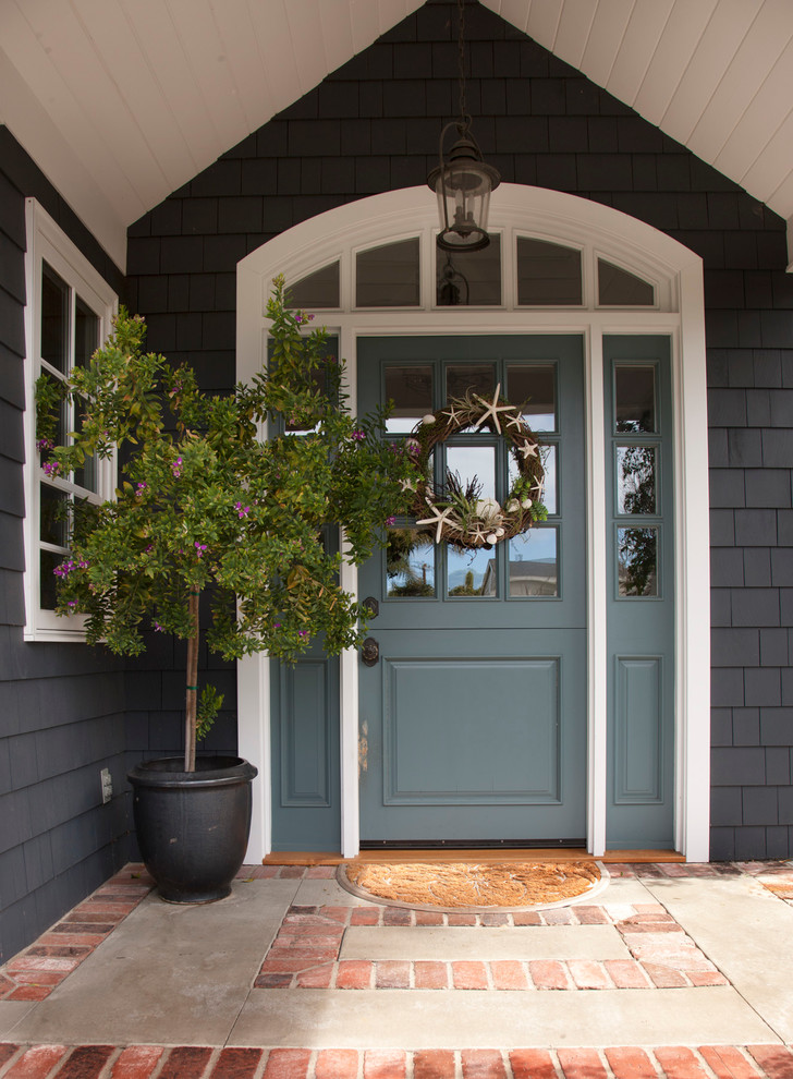 front door wreaths Entry Traditional with beach cottage blue door brick classical coastal entry front door front porch