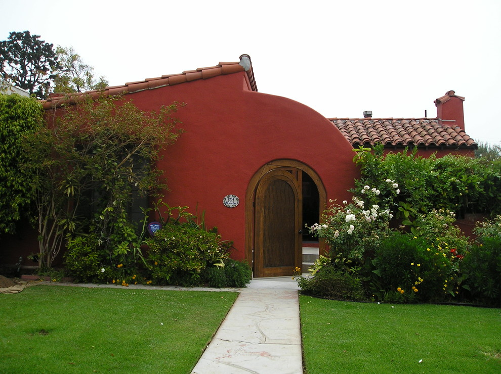 Garden Hose Holder Exterior Mediterranean with Arched Front Door Bushes Clay Roof Tile Concrete Pathway Concrete Walkway Entry